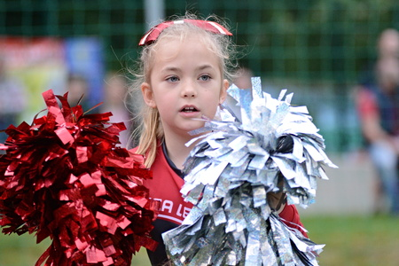JIHLAVA 05.29.2016 _ Little girl cheerleader. 5.round of Czech Football League Division IV Between the teams and the Gladiators Vysocina and Zlin Golems. Redakční