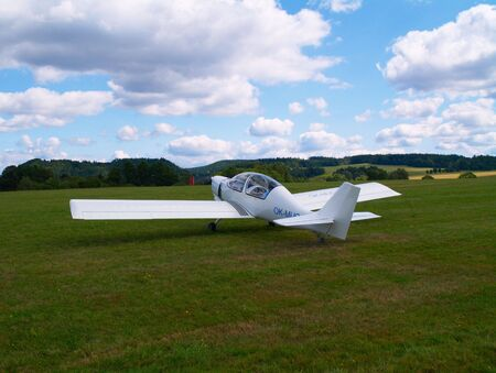 airfield: small airplane on a airfield Stock Photo
