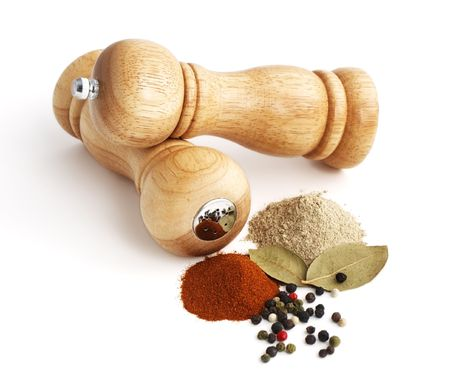 pepper mill and spices isolated on white background photo