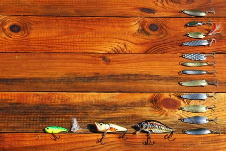 spinner: spinner fishing on wooden background