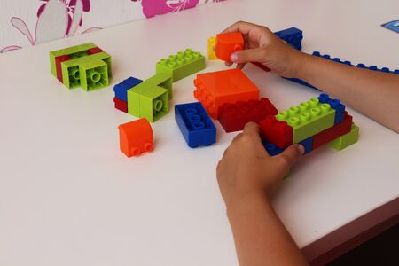 designer baby: a child plays on the table with the designer
