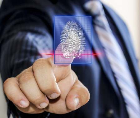 The latest technology of the access via the fingerprint scanner.Fingerprint scanning for secure access. Stock Photo