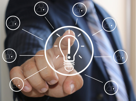 virtual community: The concept of innovation and promotion of business ideas .Business, technology concept - pressing the button with the light bulb ideas on virtual screens. Cyber ??idea.The business community, employees.