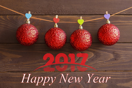 to weigh: 2017 happy new year and Christmas. Red Christmas tree balls weigh primako with hearts.