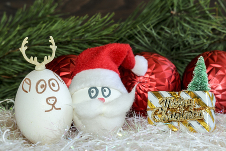 Santa Claus and Christmas deer on New year and Christmas .Unusual eggs with the faces, muzzle.Christmas cartoon, decorations.