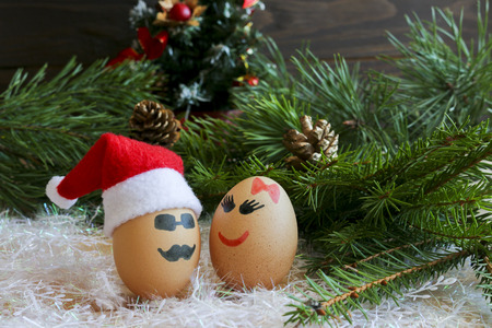 Lovers on New year and Christmas. Unusual eggs with faces, faces. The love of two eggs, cartoon Christmas.