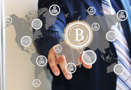 ides: Businessman, choosing bitcoins clicks on the touch screen. The latest technology work with Finance in the networks. The concept of distribution of bitcoins. Web icons.