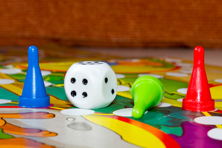 plastic chips, dice and board games for children. Stock Photo