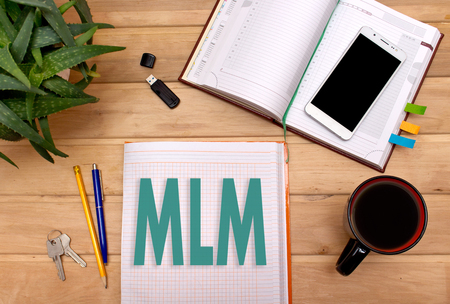 Notes MLM In The Notepad On The Desk Of A Businessman. Stock Photo, Picture  And Royalty Free Image. Image 75805958.