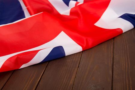 木製の背景のイギリス国旗の。テンプレートを宣伝する場所。
