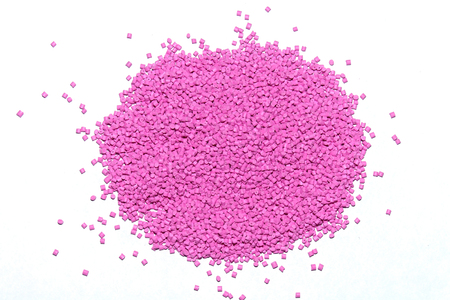 The plastic granules. Polymeric  pink dye . Dye for plastics in granules .
