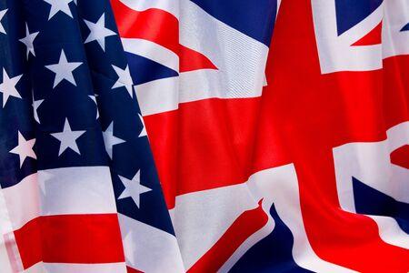 british money: USA flag and UK Flag background. Stock Photo