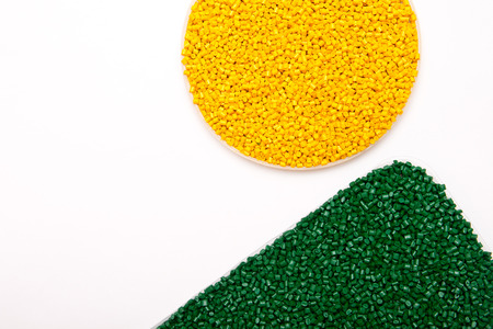 The plastic granules. Polymeric dye isolated on white background.