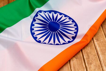 The Flag Of The Republic Of India on wooden background. The place to advertise, template.View top.