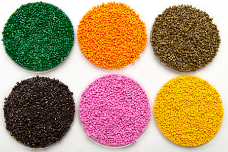 Plastic pellets. Colorant for polymers in granules. Stock Photo