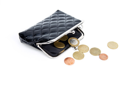 uk money: Coins from the old wallet on a white background. Vintage empty purse. The concept of poverty in retirement. Stock Photo