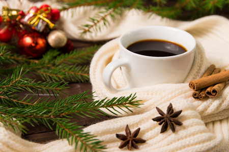 Christmas decorations and hot drink in a white Cup. The concept of comfort in Christmas. Stock Photo
