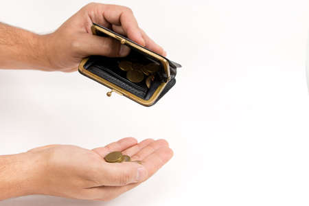 Man holding an very old wallet over an of hand with coins . The concept of poverty. The place to advertise, template.