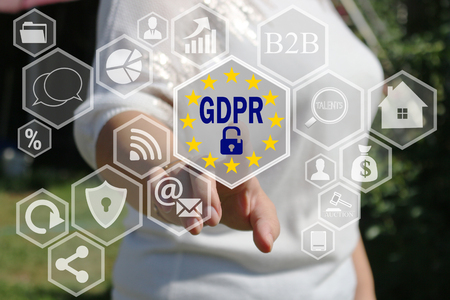 The businesswoman chooses the GDPR on the touch screen .General Data Protection Regulation concept . Stock Photo