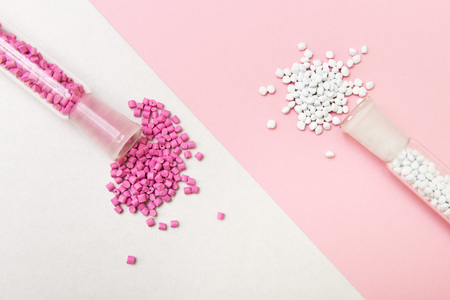 Plastic pellets. Plastic granules on a geometric background. Plastic Raw material . Stock fotó