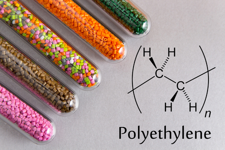 Granules of the POLYETHYLENE, chemical formula. Plastic pellets and scheme of the chemical structure .Colored Plastic Granules. Zdjęcie Seryjne