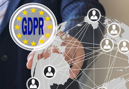 The businessman chooses the GDPR on the touch screen. General Data Protection Regulation. The concept of familiarization of people with the GDPR