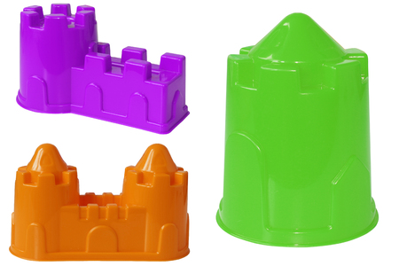 Plastic colored shapes for children play with sand, isolated on a white background. Baby plastic molds to build a sand Castle.