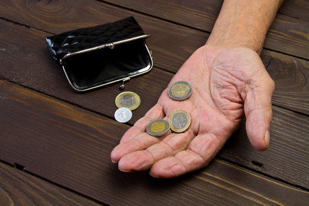 Begging for money. Elderly person Hands of beggar with few coins. The concept of poverty Reklamní fotografie