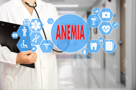 Medical Doctor with stethoscope and word ANEMIA, aplastic anemia  in Medical network connection on the virtual screen on hospital background.Technology and medicine concept. Foto de archivo - 97737213