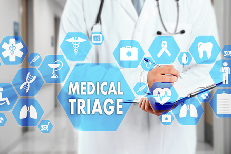 Medical Doctor with stethoscope and MEDICAL TRIAGE sign in Medical network connection on the virtual screen on hospital background.Technology and medicine concept.