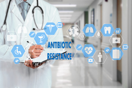 Medical Doctor  and ANTIBIOTIC RESISTANCE words in Medical network connection on the virtual screen on hospital background.Technology and medicine concept.