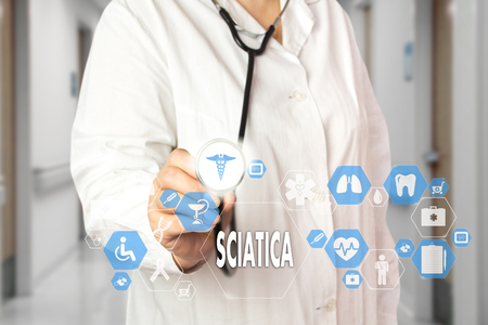 Medical Doctor  and words SCIATICA  in Medical network connection on the virtual screen on hospital background. Stock Photo