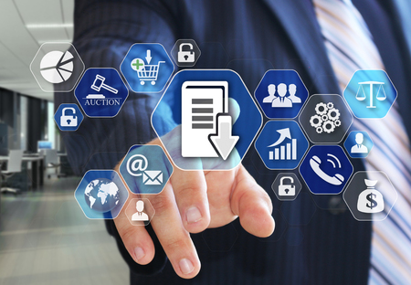 The businessman chooses Document management system, DSM on the virtual screen in social network connection. Stock Photo