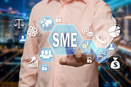 The businessman chooses the Small and Medium Enterprise, SME on the virtual screen in the business network connection. Stock Photo