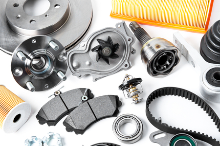 Auto parts background. Hub, pump, brake pads, filter, timing belt, rollers, constant velocity joints, thermostat and other on white background