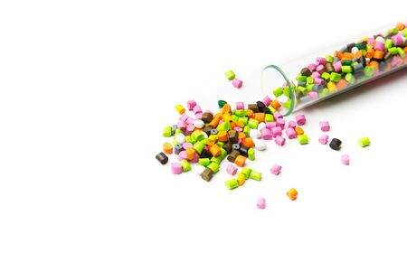 Plastic pallets .Multicolored Plastic granules. Plastic raw materials in granules for industry. Polymeric dye multicolor on a white background. Plastic granules after processing of waste polyethylene and polypropylene.Polymer