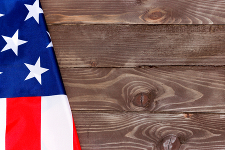 The Flag of the United States of America on wooden background Stock Photo