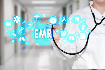 Electronic medical records. EMR on the touch screen with medicine icons on the background blur Doctor in hospital.