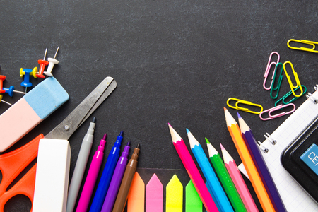 School supplies on blackboard background . The concept of education, study, learning, elearning. Back to school Stock Photo