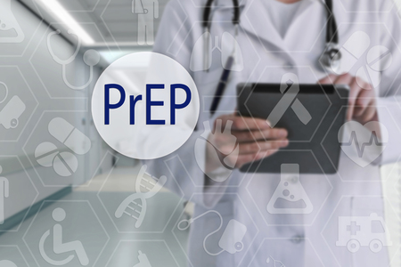 PrEP on the touch screen with medicine icons on the background blur Doctor in hospital.Innovation treatment, service, data analysis health. Medical Healthcare Concept Pre-Exposure Prophylaxis prevent HIV Stock Photo
