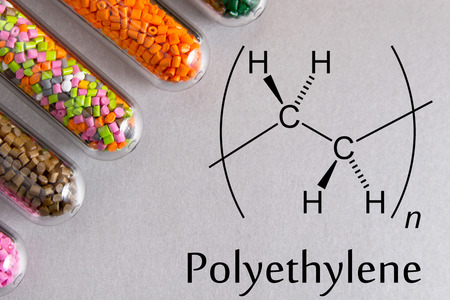 Granules of the POLYETHYLENE, chemical formula. Plastic pellets and scheme of the chemical structure .Colored Plastic Granules. Stock Photo