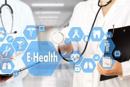 Medical Doctor with stethoscope and E-Health word in Medical network connection on the virtual screen on hospital background.Technology and medicine concept.