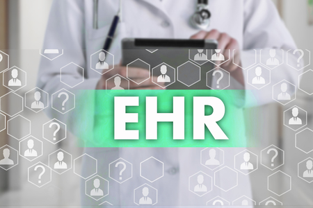 Electronic health record. EHR on the touch screen with medicine icons on the background blur Doctor in hospital.Innovation treatment, service, data analysis health. Medical Healthcare Concept Electronic health record, EHRound Stock Photo