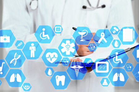 Medical network connection on the virtual touch screen and Doctor with stethoscope in hospital background.Technology and medicine concept.