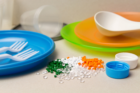 Plastic disposable tableware and Plastic Raw material. Colored granules of polyethylene, polypropylene. BPA FREE concept