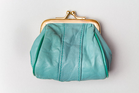 Purse for coins.Wallet for change. Leather purse. Turquoise purse on a grey background. Color of the trend.The concept of poverty Stock fotó - 114365792