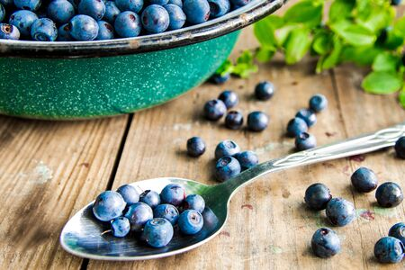 Fresh Bilberries from a bowl on old wooden table. Stock fotó - 125076220
