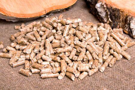Wood pellets and birch close up .Wooden pallet biofuel. Biomass Pellets-cheap energy. The cat litter.