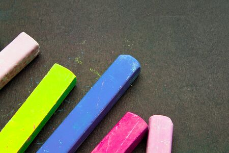 Dark chalkboard with colored crayons for drawing. Copy space Reklamní fotografie
