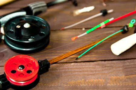 Tackle for winter fishing. Fishing rods and accessories on a wooden table. The view from the top. Stock fotó - 125076667
